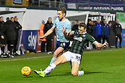 Sam Finley (14) of Accrington Stanley is tackled by Luke Jephcott (35) of Plymouth Argyle during the EFL Sky Bet League 1 match between Plymouth Argyle and Accrington Stanley at Home Park, Plymouth, England on 22 December 2018.