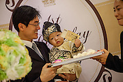 """Dol"" (in Korean language) is celebrated for the first birthday of a child. According to the tradition the parents present the child items as brush, pencil, bow and arrow, money,  needle, ruler and pair of scissors for girls). The item the child picks up are said to predict the child's future. If a child picks up the bow and arrow, it is said that the child will be strong and a warrior. If the child picks up the thread, the child will have a long life. A child who picks up the pencil, book or calligraphy set is forecast to be a good scholar. A child who picks money will become rich in the future."