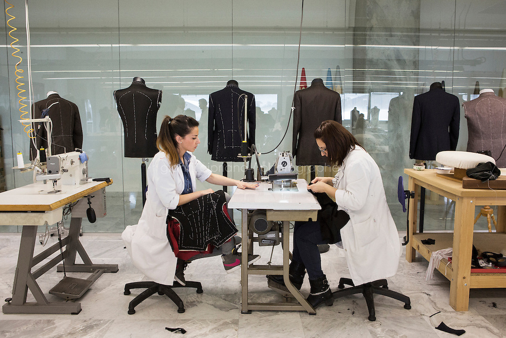 ARZANO, ITALY - 10 APRIL 2014: Students are here at work at the Kiton Tailoring School at the Kiton headquarters in Arzano, Italy, on April 16th 2014.<br /> <br /> Kiton is a luxury clothing company co-founded in 1956  in Naples by Ciro Paone, a fifth-generation fabric merchant. Launched in 1968, the brand produces suits, overcoats, ties, shirts, trousers, knitwear, outwear, shoes, leather accessories, and bags,  womenswear, fragrances and eyewear. Kiton produces 22,000 men suits per year and their sales proceeds was of 95mln euros.