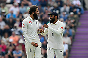 Adil Rashid of England gives Moeen Ali of England encouragement before trying to take a hatrick during day two of the fourth SpecSavers International Test Match 2018 match between England and India at the Ageas Bowl, Southampton, United Kingdom on 31 August 2018.