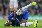 Chelsea defender Kurt Zouma (15) holds his throat after a challenge during the Champions League match between Chelsea and Lille OSC at Stamford Bridge, London, England on 10 December 2019.