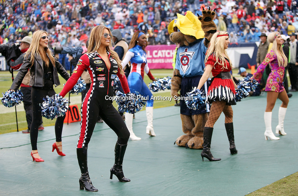 A group of Tennessee Titans cheerleaders dressed in Halloween costumes cheer during the Tennessee Titans 2015 week 7 regular season NFL football game against the Atlanta Falcons on Sunday, Oct. 25, 2015 in Nashville, Tenn. The Falcons won the game 10-7. (©Paul Anthony Spinelli)