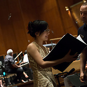 June 3, 2014 - New York, NY : Composer Wang Lu, left, works with mentor composer Derek Bermel during a rehearsal of her composition by the New York Philharmonic at Avery Fisher Hall on Tuesday. Three works by little-known composers, such as Lu, will be selected for inclusion in the New York Philharmonic's Biennial. CREDIT: Karsten Moran for The New York Times