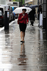 © Licensed to London News Pictures. 08/05/2014<br /> Umbrellas up today in London.<br /> London gets wet this morning (08.05.2014) Umbrellas out at Crosswall,City of London.<br /> Photo credit :Grant Falvey/LNP