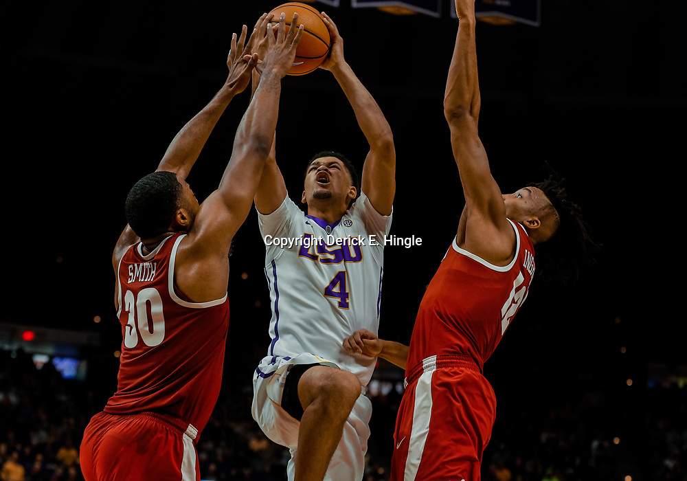 Jan 13, 2018; Baton Rouge, LA, USA; LSU Tigers guard Skylar Mays (4) shoots over Alabama Crimson Tide forward Galin Smith (30) and guard Dazon Ingram (12) during the second half at the Pete Maravich Assembly Center. Alabama defeated LSU 74-66.  Mandatory Credit: Derick E. Hingle-USA TODAY Sports