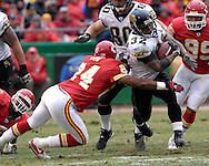 Jacksonville Jaguars running back Maurice Jones-Drew (32) rushes up field in the first half, as Kansas City defensive back Ty Law (24) tries to make the tackle at Arrowhead Stadium in Kansas City, Missouri, December 31, 2006.  The Chiefs beat the Jaguars 35-30.<br />