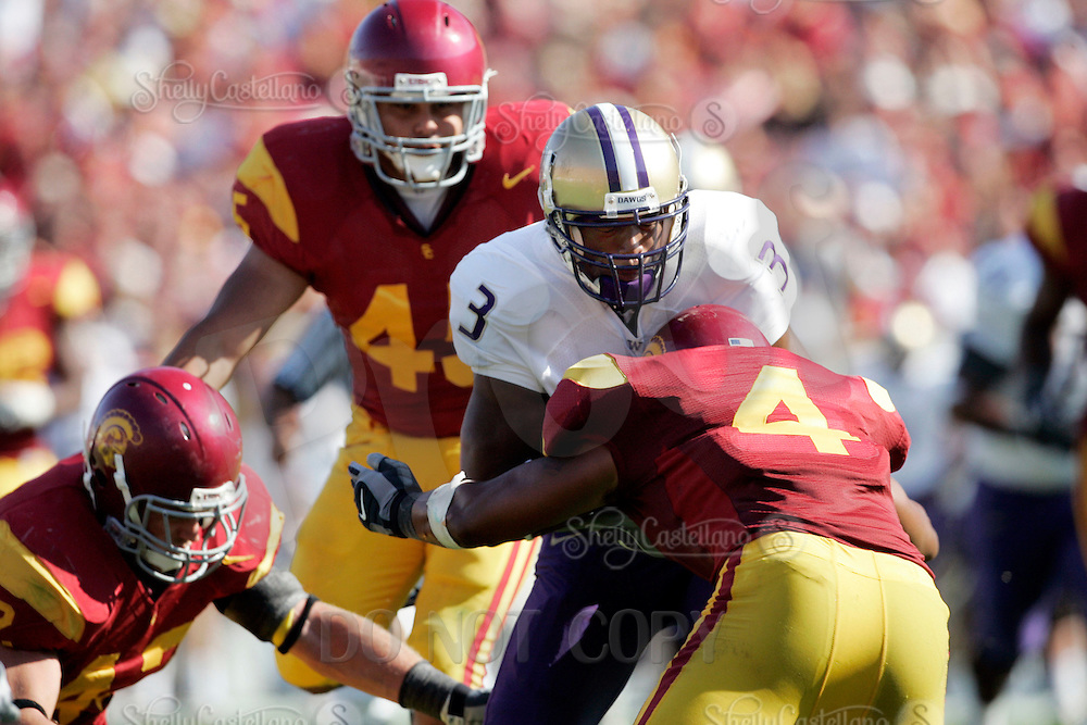 7 October 2006:  #4 Kevin Ellison SS tackles #3  Marcel Reece in the chest when he has the ball during NCAA College Football Pac-10 USC Trojans 26-6 win over the Washington Huskies at the LA Coliseum during a sunny saturday game in Los Angeles, CA.<br />