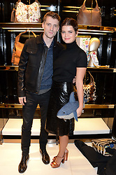 PIXIE GELDOF and GEORGE BARNETT at a party hosted by Gucci & Clara Paget to drink a new cocktail 'I Bamboo You' held at Gucci, 34 Old Bond Street, London on 16th October 2013.