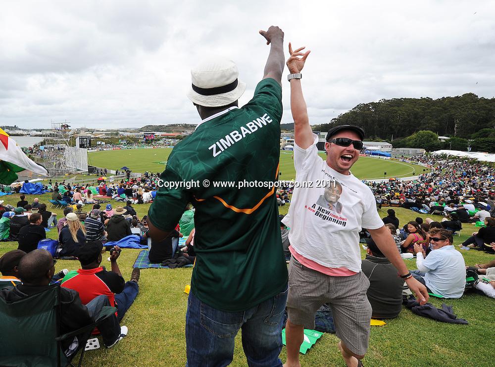 Zimbabwe fans celebrate a wicket at the 2nd ODI cricket match between New Zealand and Zimbabwe at Cobham Oval in Whangarei, Monday 6 February 2012. Napier, New Zealand. Photo: Andrew Cornaga/Photosport.co.nz