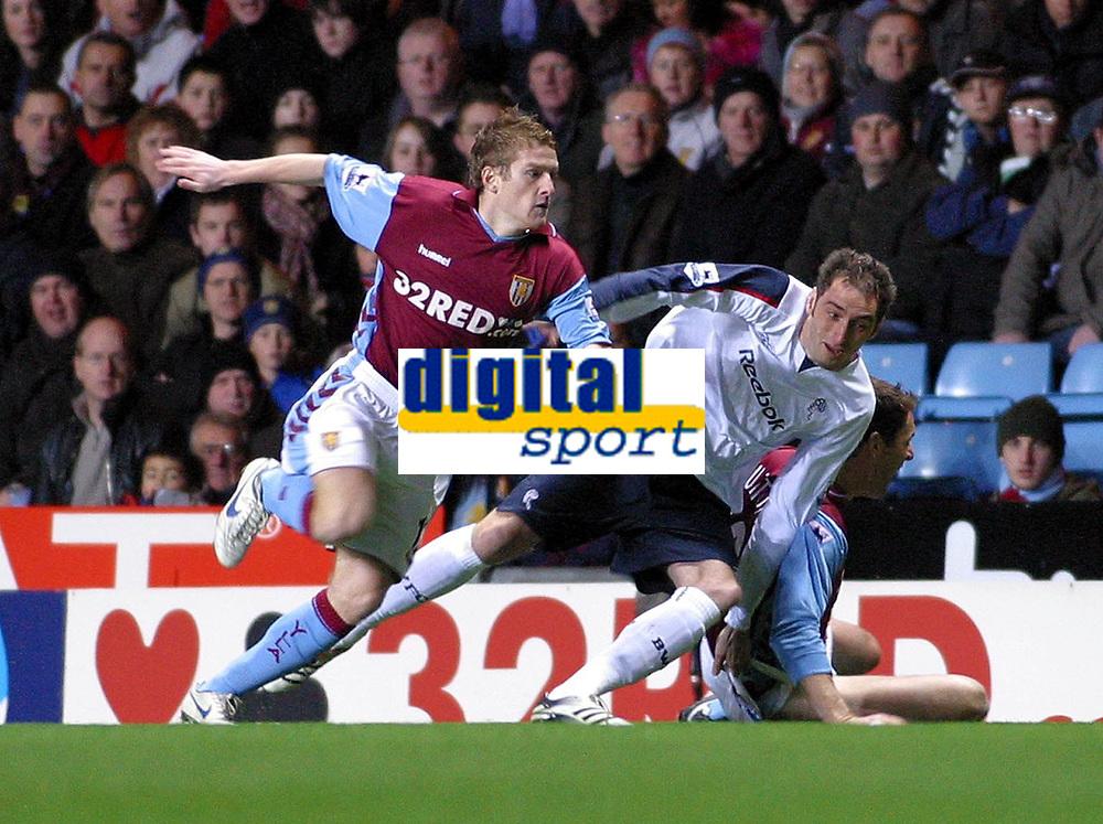 Photo: Dave Linney.<br />Aston Villa v Bolton Wanderers. The Barclays Premiership. 16/12/2006. Villa's  Steven Davis(L)  &  Nicky Hunt go to ground at Villa Park tonight.