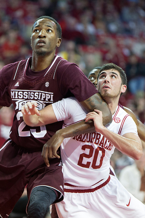 FAYETTEVILLE, AR - JANUARY 23:  Kikko Haydar #20 of the Arkansas Razorbacks battles for a rebound against Roguez Johnson #25 of the Mississippi State Bulldogs at Bud Walton Arena on January 23, 2013 in Fayetteville, Arkansas. The Razorbacks defeated the Bulldogs 96-70.  (Photo by Wesley Hitt/Getty Images) *** Local Caption *** Kikko Haydar; Roguez Johnson