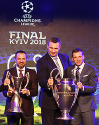 December 12, 2017 - Kiev, Ukraine - Ukraine's national soccer team coach Andriy Shevchenko (R) and Kiev Mayor Vitali Klitschko (C) pose with the UEFA Champions League trophy, during the presentation of the logo of the 2018 Champions League final soccer match in Kiev, Ukraine, 12 December, 2017.  The UEFA Champions League final will be played at the Olimpiyskiy stadium on 26 May 2018 in Kiev. (Credit Image: © Str/NurPhoto via ZUMA Press)