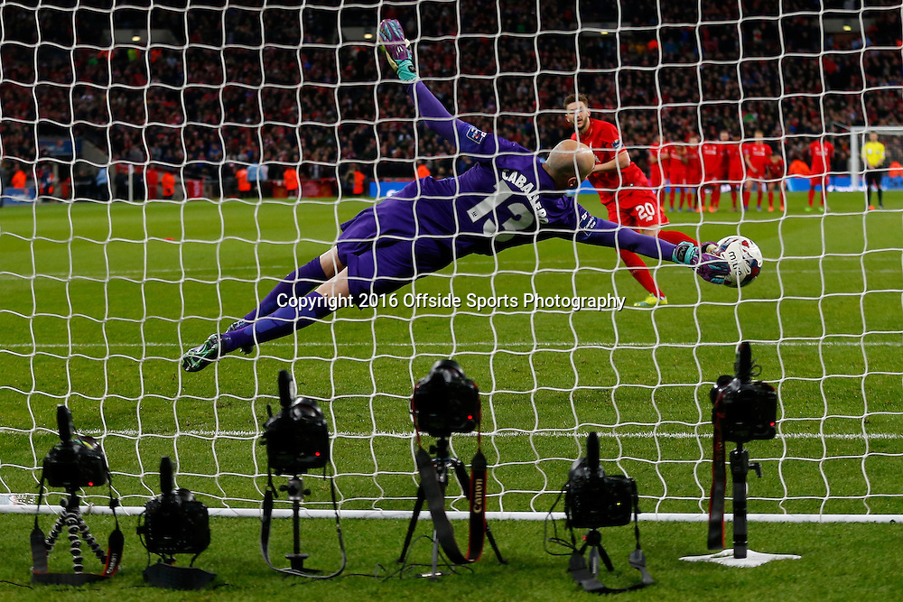 28 February 2016 - The Capital One Cup Final - Liverpool v Manchester City - Wilfredo Caballero of Manchester City saves from Adam Lallana of Liverpool - Photo: Marc Atkins / Offside.