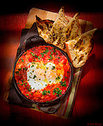 Shakshuka, a Middle Eastern dish of eggs poached and baked in a spicy tomato sauce, here at the 27 Restaurant in Miami Beach's Freehand Hotel. Image © Bill Wisser, All Rights Reserved