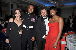 Left to right, ROBERT & the HON.MARION LAWRENCE, JOHNSON BEHARRY VC and TAMARA VINCENT at the Matterhorn Challenge Ball in aid of Combat Stress as part of their 90th anniversary celebrations held at The Berkeley Hotel, London on 11th June 2009.