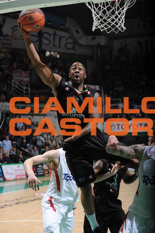 DESCRIZIONE : Siena Eurolega 2011-12 Montepaschi Siena Olympiakos<br /> GIOCATORE : Bo Mc Calebb<br /> CATEGORIA : tiro<br /> SQUADRA : Montepaschi Siena <br /> EVENTO : Eurolega 2011-2012<br /> GARA : Montepaschi Siena Olympiakos<br /> DATA : 23/03/2012<br /> SPORT : Pallacanestro <br /> AUTORE : Agenzia Ciamillo-Castoria/GiulioCiamillo<br /> Galleria : Eurolega 2011-2012<br /> Fotonotizia : Siena Eurolega 2011-12 Montepaschi Siena Olympiakos<br /> Predefinita :