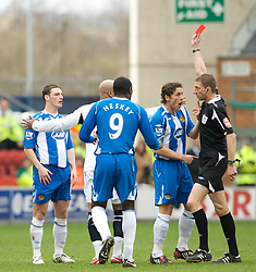 WIGAN, ENGLAND - Sunday, March 16, 2008: Wigan Athletic's Jason Koumas is shown the red card and sent off by referee Steve Tanner in the opening minutes of the Premiership match against Bolton Wanderers at the JJB Stadium. (Photo by David Rawcliffe/Propaganda)