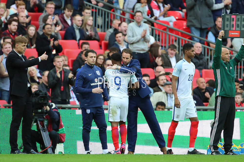 Jermain Defoe of England subbed and getting a hug from England Manager Gareth Southgate during the FIFA World Cup Qualifier group stage match between England and Lithuania at Wembley Stadium, London, England on 26 March 2017. Photo by Matthew Redman.