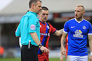 Referee Chris Sarginson sends Donal McDermott off a second red card for Rochdale during the EFL Sky Bet League 1 match between Peterborough United and Rochdale at London Road, Peterborough, England on 25 February 2017. Photo by Daniel Youngs.