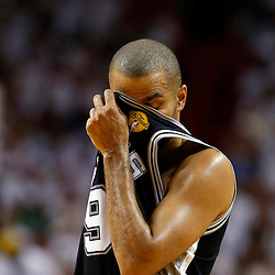 Jun 18, 2013; Miami, FL, USA; San Antonio Spurs point guard Tony Parker (9) reacts during the second quarter of game six in the 2013 NBA Finals against the Miami Heat at American Airlines Arena.  Mandatory Credit: Derick E. Hingle-USA TODAY Sports