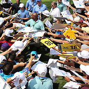 Rory McIlroy, is besieged by autograph hunters at the end of his ProAm round during The Barclays Golf Tournament at The Ridgewood Country Club, Paramus, New Jersey, USA. USA. 20th August 2014. Photo Tim Clayton