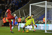 Late attempt on goal by Blackburn Rovers striker Bangali-Fode Koita is saved by Reading's goalkeeper Jonathan Bond during the Sky Bet Championship match between Reading and Blackburn Rovers at the Madejski Stadium, Reading, England on 3 December 2015. Photo by Mark Davies.