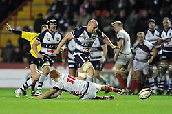 Bristol Rugby openside flanker, Josh Ovens kicks the ball past London Scottish fly half, new signing Connor Braid - Photo mandatory by-line: Dougie Allward/JMP - Mobile: 07966 386802 - 05/12/2014 - SPORT - Rugby - Bristol - Ashton Gate - Bristol Rugby v London Scottish - B&I Cup
