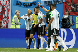 (l-r) Javier Mascherano of Argentina, referee Cuneyt Cakir, Nicolas Otamendi of Argentina during the 2018 FIFA World Cup Russia group  D match between Nigeria and Argentina at the Saint Petersburg Stadium on June 26, 2018 in Saint Petersburg, Russia