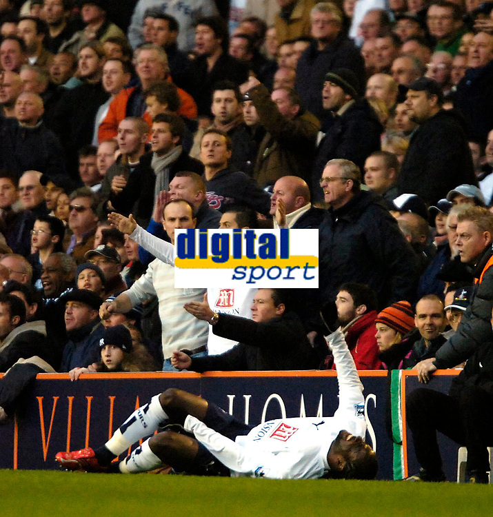 Photo: Ed Godden.<br /> Tottenham Hotspur v Chelsea. The Barclays Premiership. 05/11/2006. Pascal Chimbonda lies injured on the floor after being fouled by Frank Lampard..
