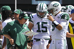 Sept 9, 2012; East Rutherford, NJ, USA; New York Jets offensive coordinator Tony Sparano talks to New York Jets quarterback Tim Tebow (15) and New York Jets quarterback Mark Sanchez (6) during the first half at MetLIfe Stadium.