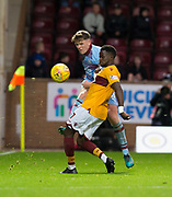 3rd November 2018, Fir Park, Motherwell, Scotland; Ladbrokes Premiership football, Motherwell versus Dundee; Lewis Spence of Dundee challenges for the ball with Gaël Bigirimana of Motherwell
