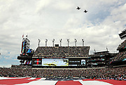 Jets fly over the stadium while a full-field sized American flag is stretched over the field in memory of the lives lost on the 15th anniversary of the 9/11 terror attack on the United States before the Philadelphia Eagles 2016 NFL week 1 regular season football game against the Cleveland Browns on Sunday, Sept. 11, 2016 in Philadelphia. The Eagles won the game 29-10. (©Paul Anthony Spinelli)
