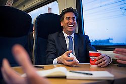 © London News Pictures. 23/04/2015. Labour Party leader Ed Miliband on a train journey from Leeds to London during the 2015 general election campaign trail. Photo credit: Ben Cawthra/LNP