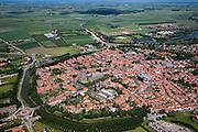 Nederland, Zeeland, Schouwen-Duiveland , 12-06-2009; Zierikzee, overzicht over het eiland Duiveland, in noordoostelijke richting naar het Grevelingenmeer. In het centrum van de historische stad, beschermd stadsgezicht, bezienswaardigheden en monumenten onder andere de Sint-Lievensmonstertoren met daarnaast de Nieuwe Kerk.Swart Collection, aerial photo (additional fee required); .foto Siebe Swart / photo Siebe Swart