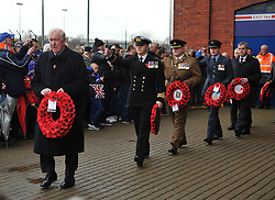 John Greig leads a procession at Ibrox in front of the Statue at Ibrox for Remembrance Sundayin the match between Rangers v Motherwell, Ladbrokes Scottish Premiership, Ibrox, Sunday 11 November 2018  (c) Angie Isac | SportPix.org.uk