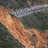 Stage 2 of the Amgen Tour of California brings riders through a cut in the hillside as cyclists near Montara on May 14.<br />Photo by Shmuel Thaler/Santa Cruz Sentinel
