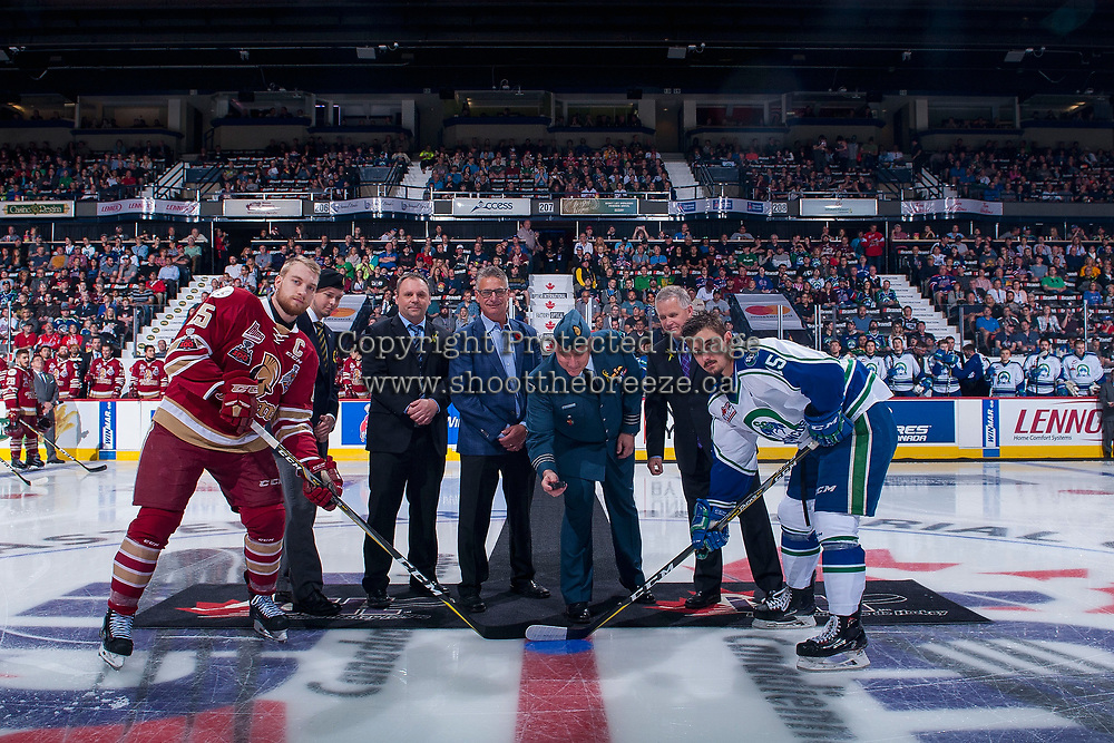REGINA, SK - MAY 19: Jeffrey Truchon-Viel #25 of Acadie-Bathurst Titan and Glenn Gawdin #15 of Swift Current Broncos stand at centre ice for the ceremonial puck drop at the Brandt Centre on May 19, 2018 in Regina, Canada. (Photo by Marissa Baecker/CHL Images)