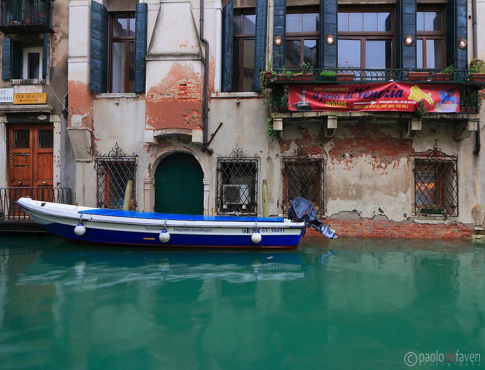 The facade of a building at Rio della Maddalena, a canal in the sestiere of Cannaregio in Venice, Italy