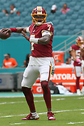 Sunday, October 13, 2019; Miami Gardens, FL USA;  Washington Redskins backup quarterback Dwayne Haskins (7) throws a pass during pregame warmups prior to an NFL game against the Dolphins at Hard Rock Stadium. The Redskins beat the Dolphins 17-16. (Kim Hukari/Image of Sport)