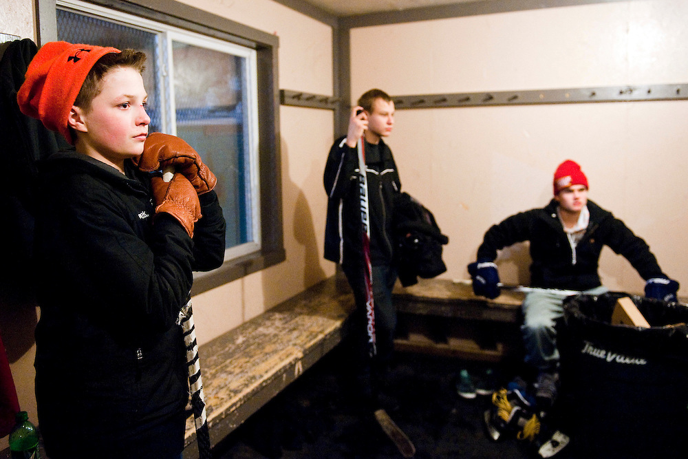 HOUGHTON, MI -DEC. 11, 2014: (left to right) Tyler Bakkila, 13, Lane Alhoinna, 18, and Travis Bessner, 17, take a break from skating at a hockey rink on Edwards Street in Houghton, MI Thursday, Dec. 11, 2014. The boys often spend hours playing hockey after school. Lauren Justice for The New York Times