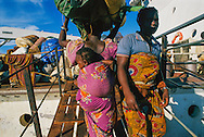 Heading home, refugees load their possessions on a ferry that will take them from Tanzania across Lake Tanganyika to the Democratic Republic of the Congo.