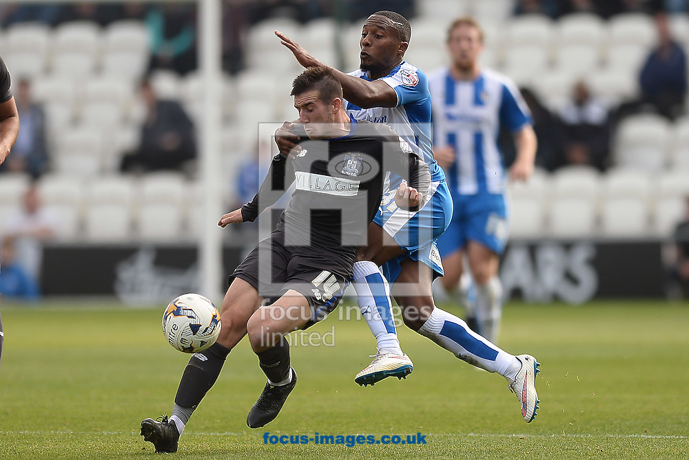 Callum Harriott of Colchester United does battle with Craig Jones of Bury during the Sky Bet League 1 match between Colchester United and Bury at the Weston Homes Community Stadium, Colchester<br /> Picture by Richard Blaxall/Focus Images Ltd +44 7853 364624<br /> 03/10/2015