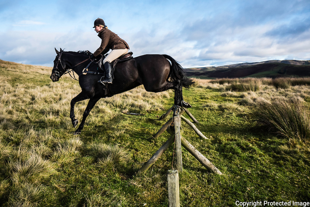Four star eventer Emily Galbraith jumps a fence while hunting with the Jedforest Hunt.