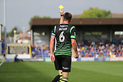 Doncaster Rovers defender Andy (Andrew) Butler (6) yellow card during the EFL Sky Bet League 1 match between AFC Wimbledon and Doncaster Rovers at the Cherry Red Records Stadium, Kingston, England on 26 August 2017. Photo by Matthew Redman.