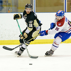 KINGSTON, - Apr 6, 2016 -  Ontario Junior Hockey League game action between Trenton Golden Hawks and Kingston Voyageurs. Game 4 of the North East Championship series.  at the Invista Centre, ON. Blayne Oliver #16 of the Trenton Golden Hawks and Colin Tonge #15 of the Kingston Voyageurs battles for the puck during the second period. (Photo by Ian Dixon / OJHL Images)