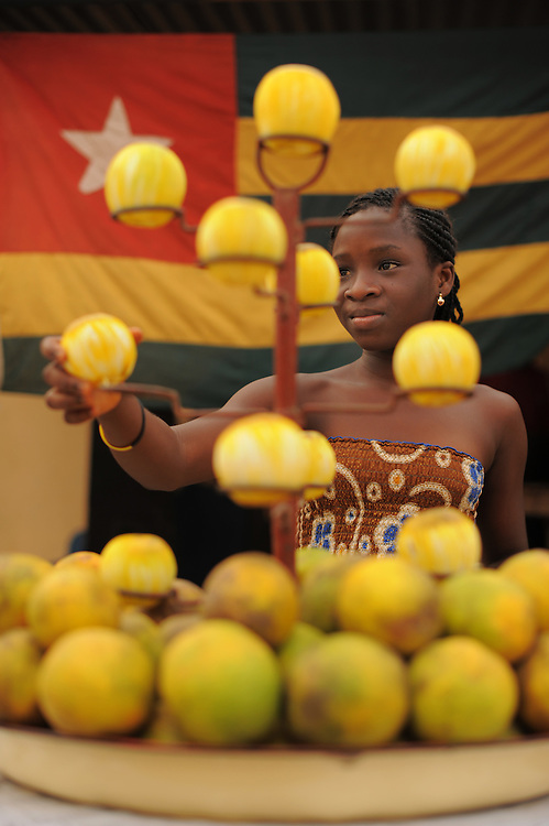 LOME, TOGO  13-02-03   -  A young woman selling oranges in Lome, Togo on February 3, 2013. Photo by Daniel Hayduk