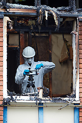 © Licensed to London News Pictures.  20/05/2013. MILTON KEYNES, UK. A police forensic investigator examines  the scene of a fatal house fire in St Leger Court, Great Lindford, Milton Keynes. Police were called at 7.58pm last night (19/5) by Buckinghamshire Fire and Rescue Service to a fire at a residential address where an occupant died. A 57-year-old man has been arrested on suspicion of murder and remains in custody. Photo credit: Cliff Hide/LNP
