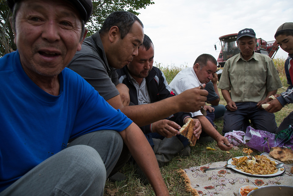 Laborers take a lunch break in a field after harvesting corn all morning. Climate change in Kyrgyzstan is affecting cross border water rights in the already ethnically divided Fergana Valley, all while glaciers melt in the Tian Shan Mountains. Tensions are rising as different groups compete for scarcer and scarcer resources.