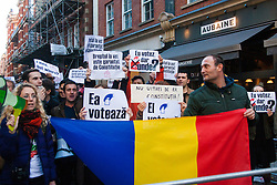 Kensington, London, November 9th 2014. Romanians in London demonstrate against the failure of their government to provide adequate voting facilities for those in the diaspora in last weeks' first round of their Presidential election. Thousands were unable to cast their votes before the 9pm deadline, with some polling stations closing a full two hours too early. Similar protests have taken place in France, Germany and Italy, Ireland, Spain and Austria. Some accuse the current Prime Minister  Victor Ponta of using this to rig the election in his favour.
