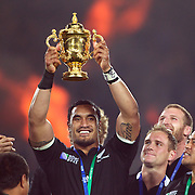 Jerome Kaino, New Zealand, holds the World Cup aloft surrounded by team mates during the trophy presentations after the New Zealand V France Final at the IRB Rugby World Cup tournament, Eden Park, Auckland, New Zealand. 23rd October 2011. Photo Tim Clayton...